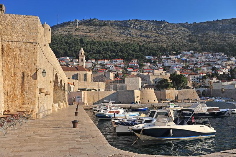 Boats at the city walls of Dubrovnik. Croatia stock images