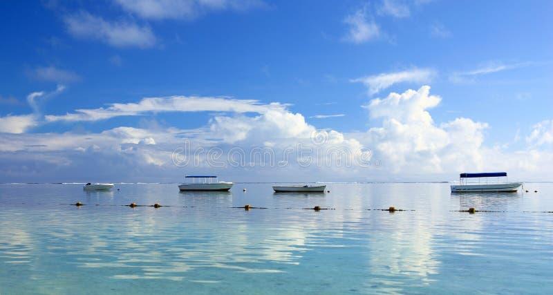 Boats at dawn stock image