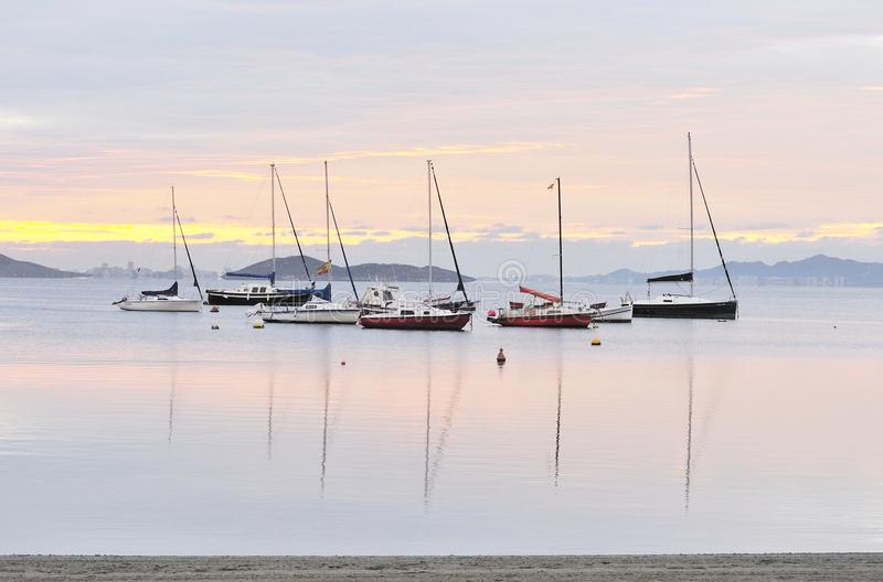 Boats at Daybreak. Sailing boats and islands at daybreak stock photo
