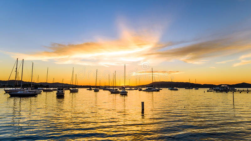 Download Boats And Daybreak At The Waterfront Stock Photo - Image: 92424494