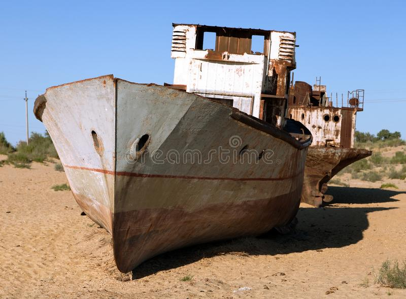 Boats in desert around Moynaq - Aral sea or Aral lake - Uzbekistan - asia. Boats in desert around Moynaq, Muynak or Moynoq - Aral sea or Aral lake - Uzbekistan royalty free stock photo