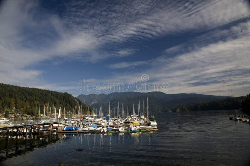 Boats at Dock Deep Cove Canada. Boats at Dock, Deep Cove, Vancouver, British Columbia Canada under Fair Weather Sky royalty free stock photos