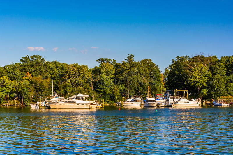Boats docked in the Back River, seen at Cox Point Park, in Essex royalty free stock photo