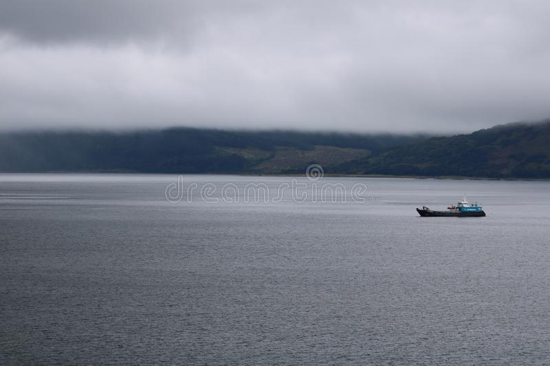 Boats docked at Fort William, Scotland in the summertime. stock photography