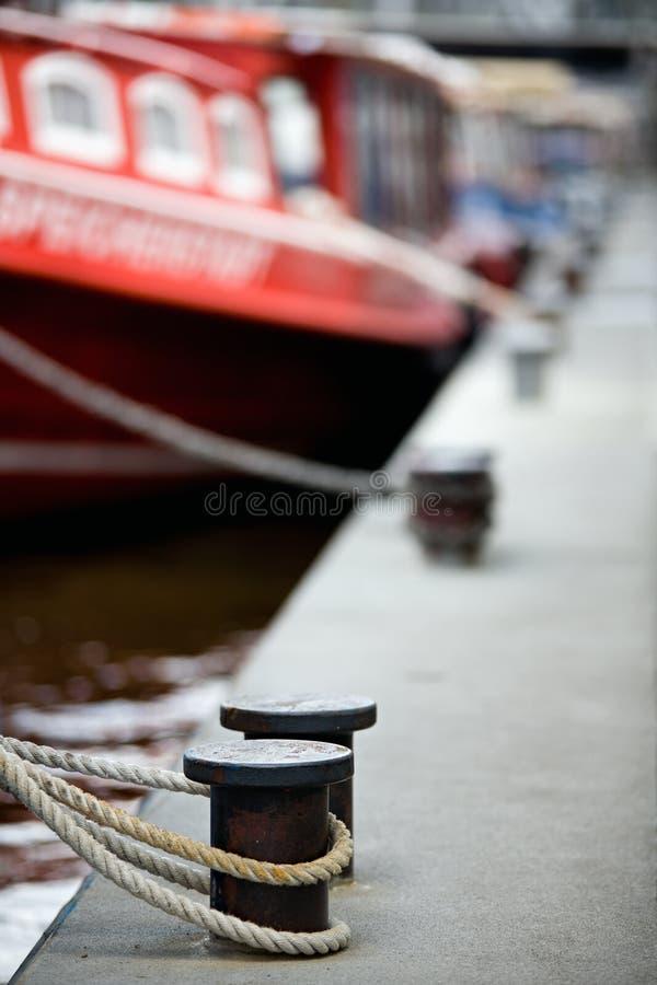 Boats docked in harbor bollards royalty free stock photos