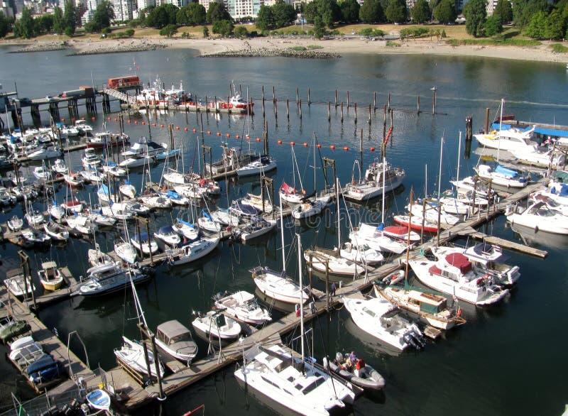 Boats docked at a harbor False Creek. Vancouver BC Canada. Boats docked at a harbor False Creek. Vancouver, British Columbia, Canada royalty free stock images