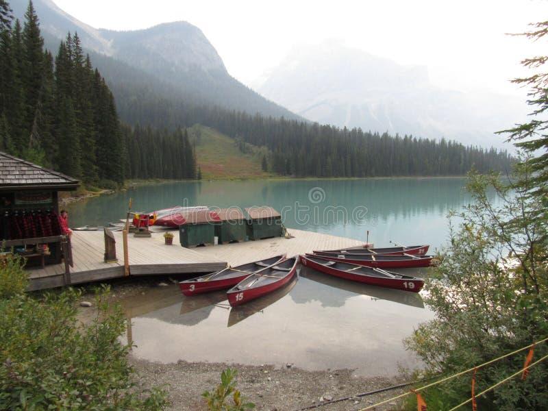 Boats on Emerald Lake, British Columbia, Canada. Boats and boat house on Emerald Lake, in Yoho National Park, British Columbia, Canada. It is the largest lake in royalty free stock image