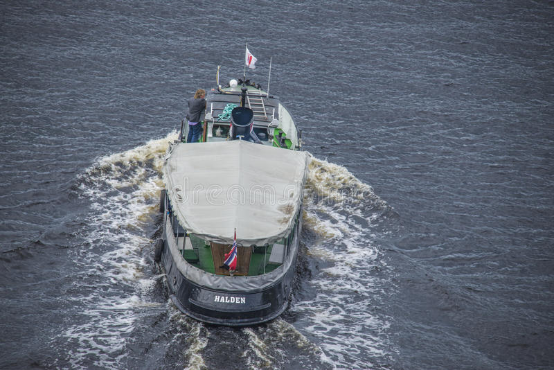 Boats in the escort fleet to ms sjøkurs. MS Sjøkurs with NRK (Norwegian Broadcasting Corporation) on board are escorted by a fleet of small boats through royalty free stock photos