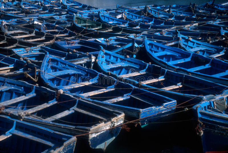 Boats of Essaouira, Morocco. Blue boats moored at the harbour of Essaouira, UNESCO World Heritage Listed city of Morocco royalty free stock images