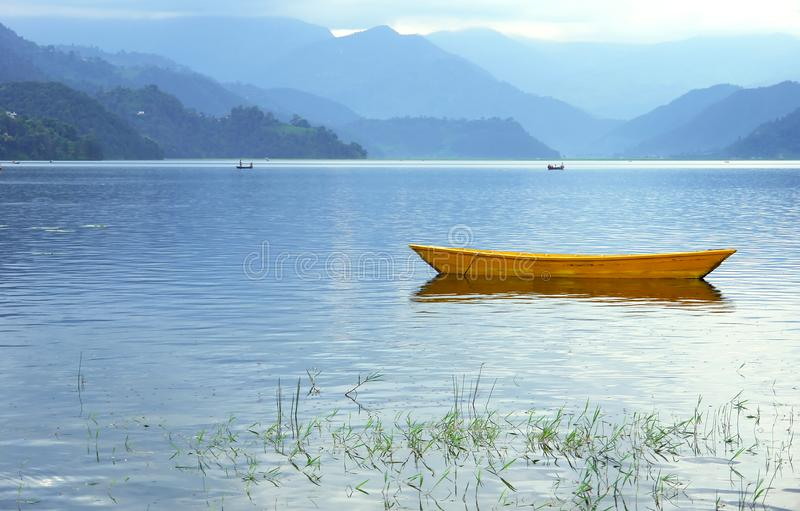 Boats in Fewa Lake stock photos