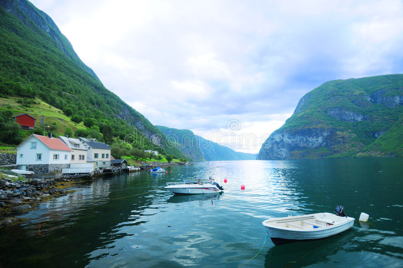 Boats in fjord stock photography