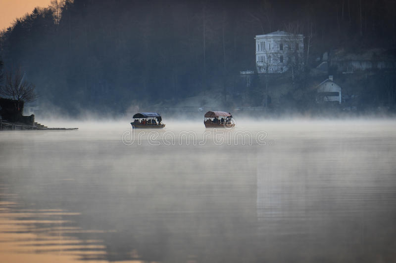 Boats Floating in Mist royalty free stock images