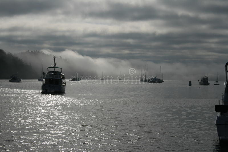 Boats at foggy Reid Harbor. Photo taken of fog and boats anchored in Reid Harbor, Stuart Island, Washington royalty free stock images