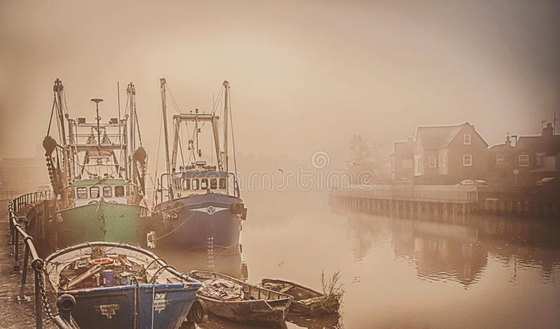 Boats on a foggy river. royalty free stock photos