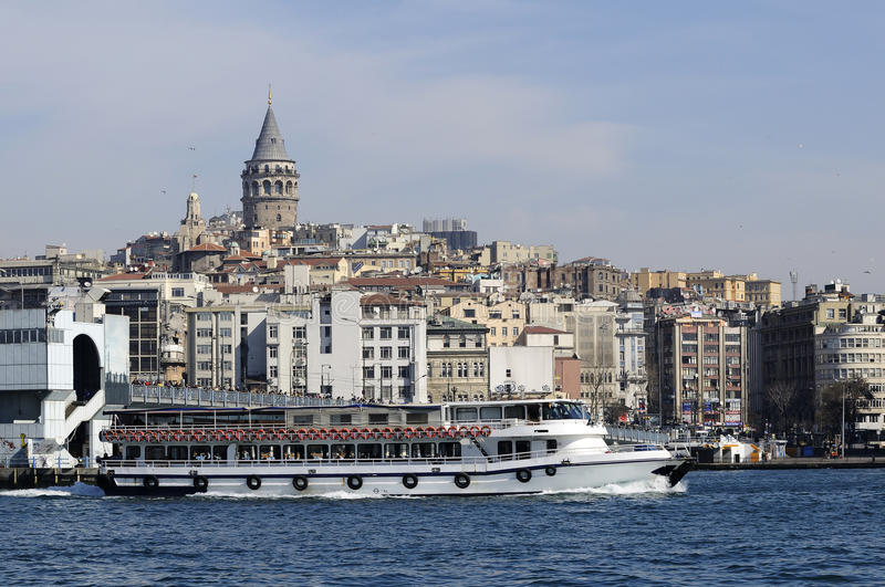 Boats and galata tower. Boats and behind galata tower in istanbul stock photo
