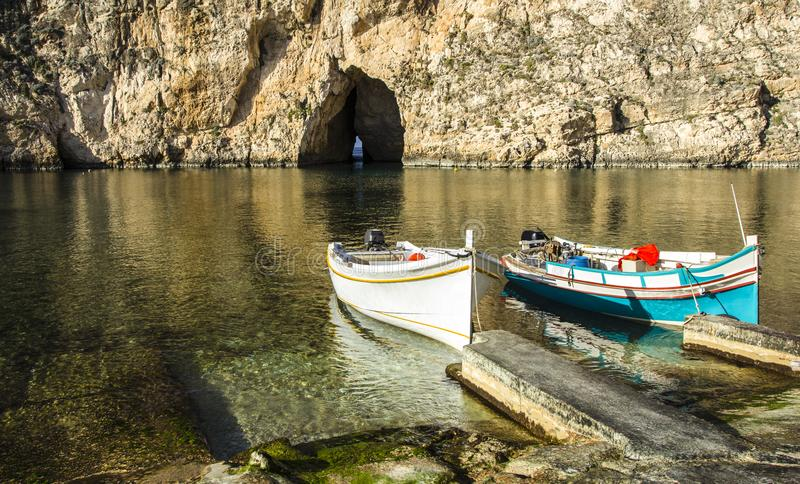 Boats at the Gozo Inland Sea. Traditional fishing boats at the Inland Sea of Gozo stock photo