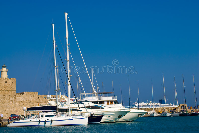 Boats at Harbor. Boats anchored in port of Rhodes. Greece royalty free stock photos