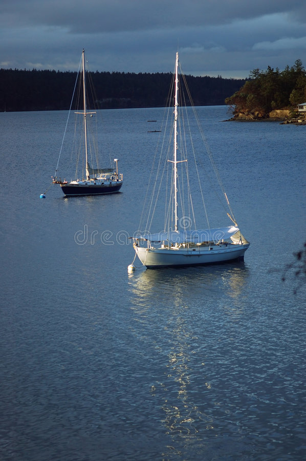 Boats in the harbor stock photography