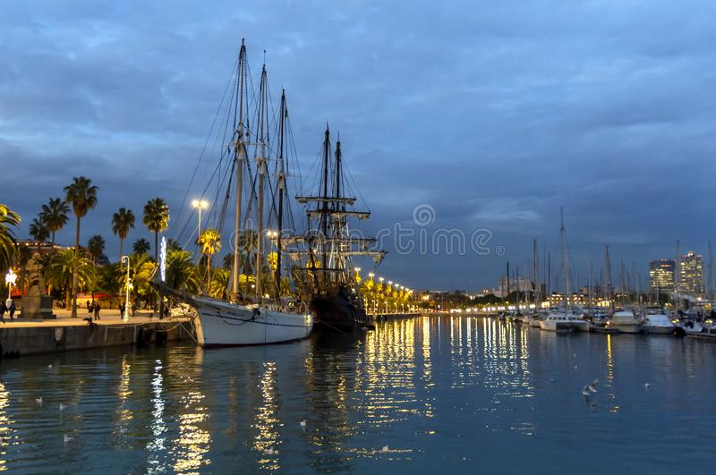 Boats in the harbor at blue hour stock image