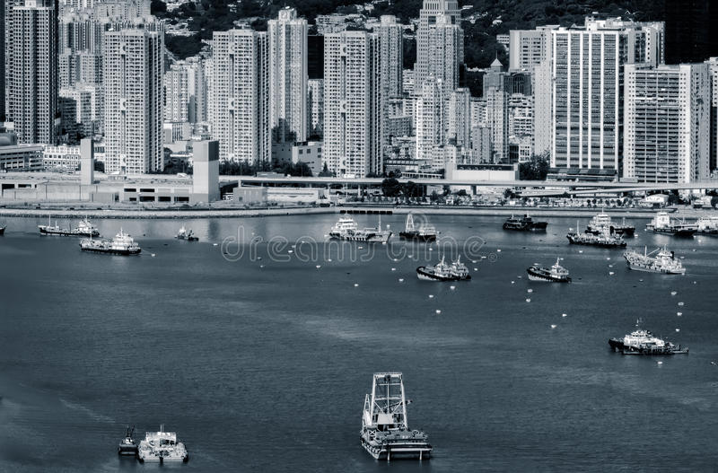 Boats in the harbor near the skyscraper stock images
