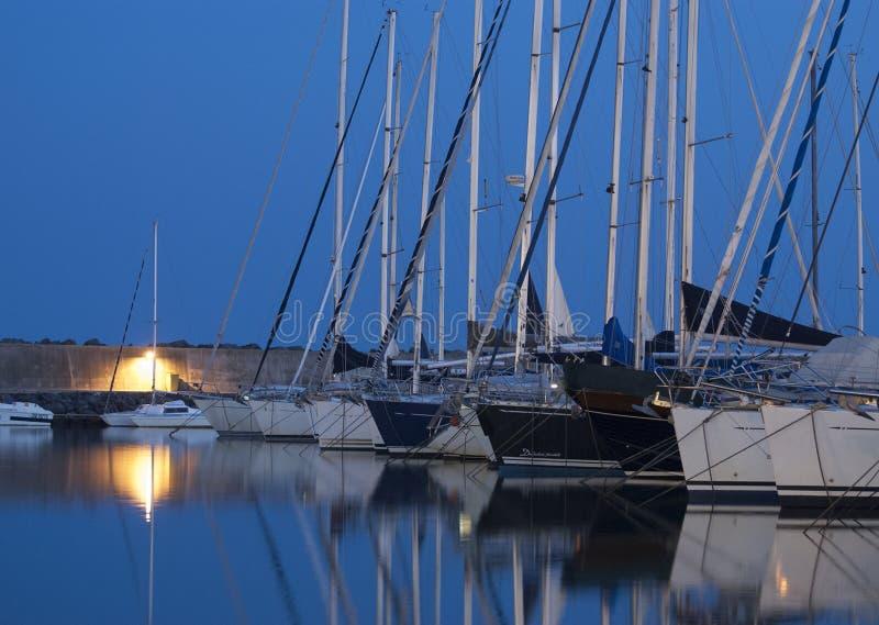 Boats in harbor at night stock photo
