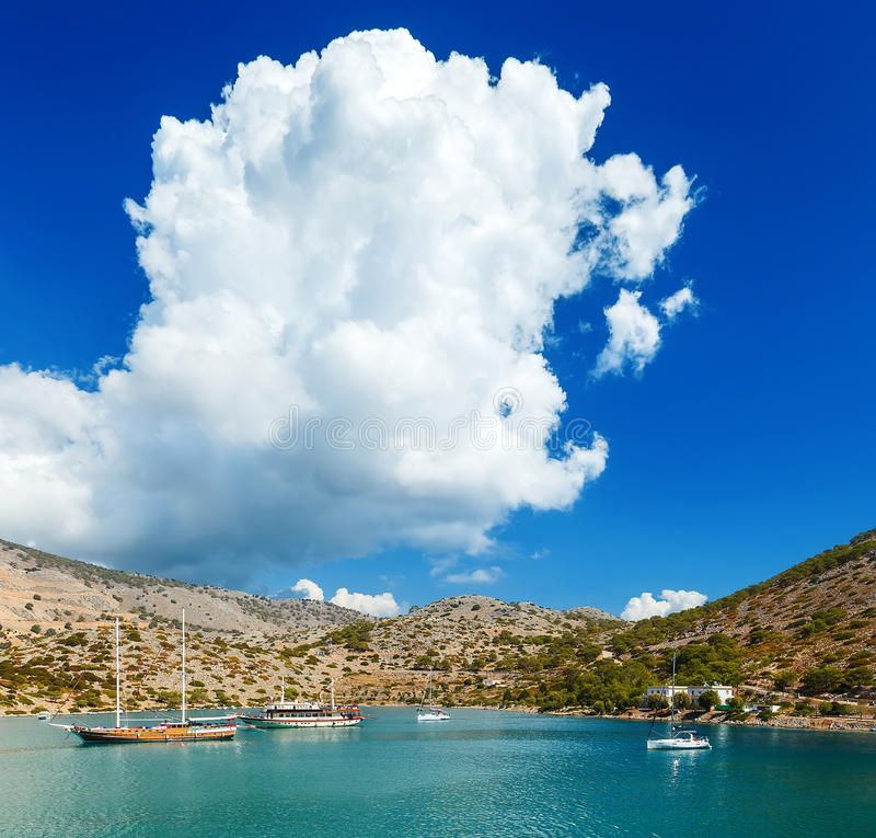 Boats in harbor of Panormitis. Symi island, Greece. stock photo