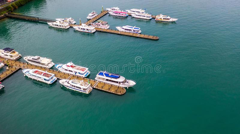 Boats in the harbor at Sun Moon Lake, Shuishe Pier in Nantou, Taiwan, Aerial top view stock photo