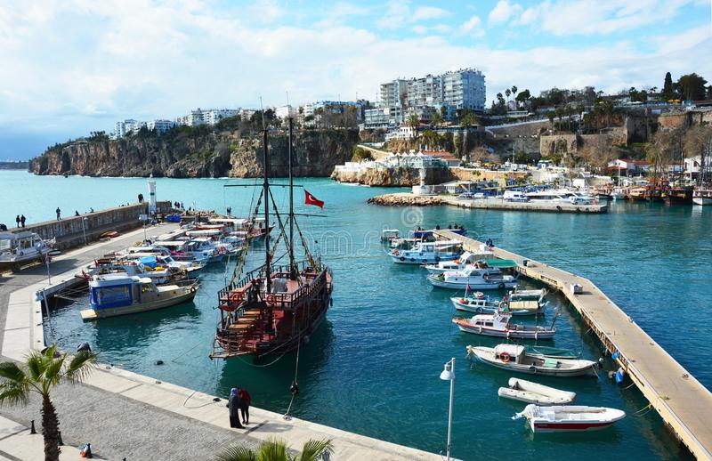 Boats in a harbour and emerald Mediterranean Sea at the Gulf of Antalya royalty free stock images