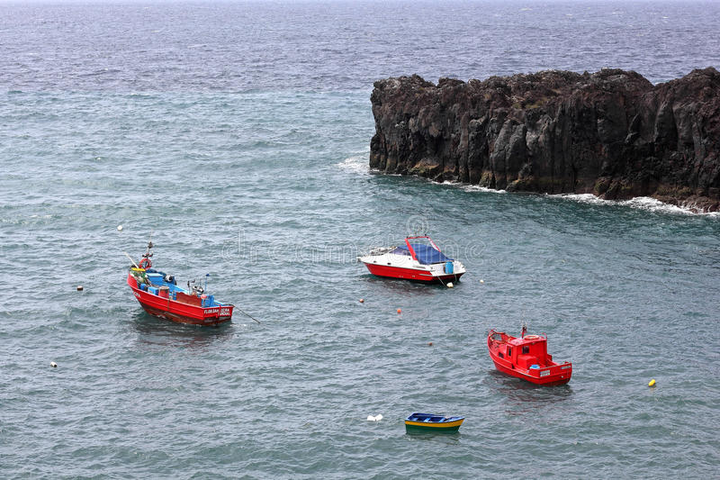 Boats at the harbour entrance of Camara de Lobos on Madeira stock photography
