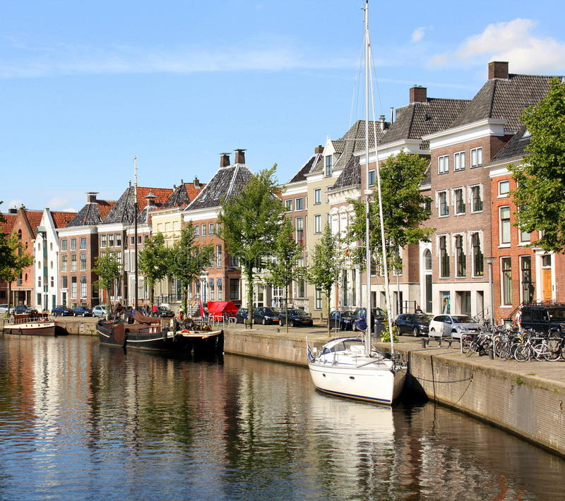 Boats and historic houses. Groningen royalty free stock image