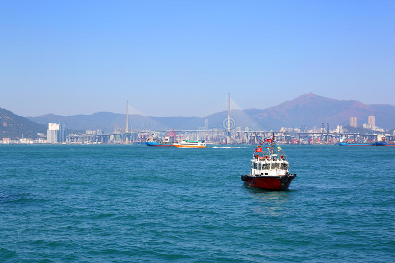 Boats in Hong Kong harbor and Stonecutters bridge. Landscape with Boats in Hong Kong harbor and Stonecutters bridge stock photography