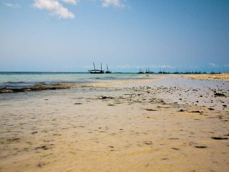 Boats are on the horizon line. Against a blue sky royalty free stock photo