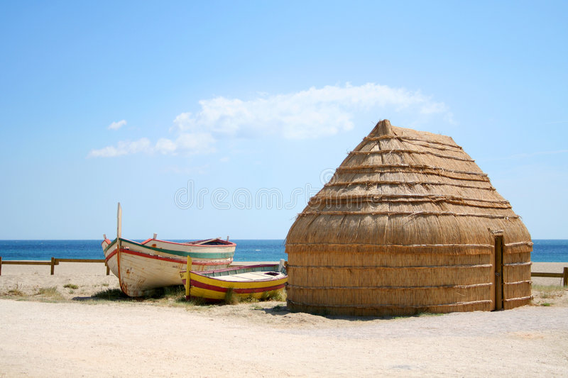 Boats and hut on beach, Port Barcares, France stock photos