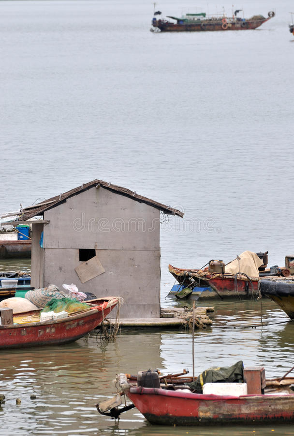 Boats and hut with poor living