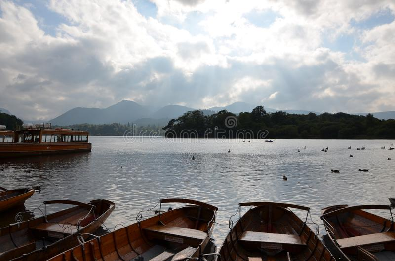 Boats and isle on lake windermere in the lake district. Cumbria, england, united kingdom royalty free stock photo