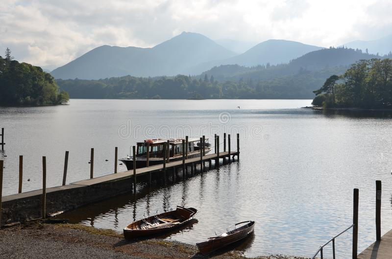 Boats and isle on lake windermere in the lake district. Cumbria, england, united kingdom stock image
