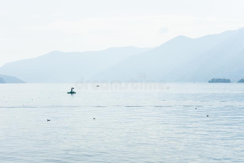 Boats on lago maggiore lake in ascona switzerland with mountain view landscape and water royalty free stock images