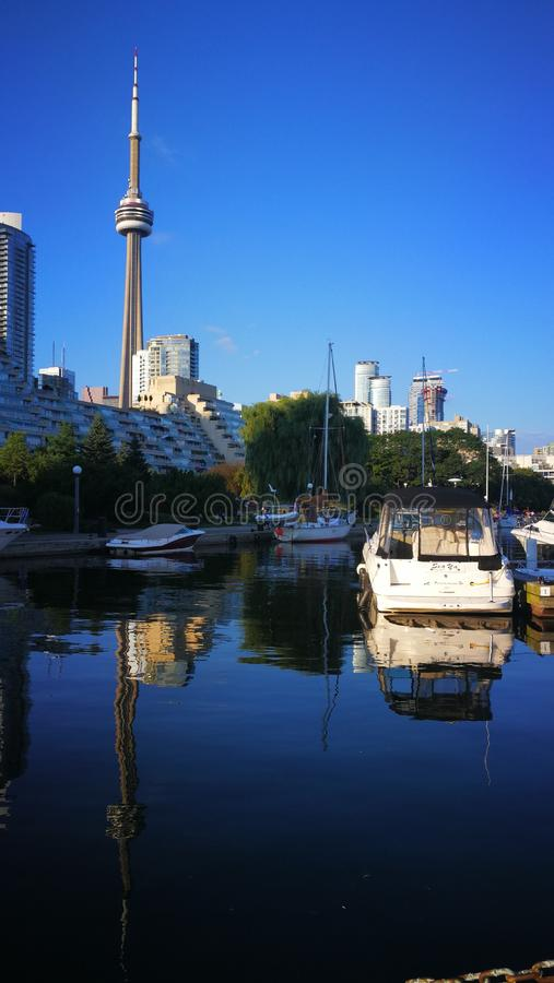 Boats on the Lake Ontario, Canada. Dark blue lake, light blue sky fill, light white clouds, leisurely fishing boats royalty free stock photography