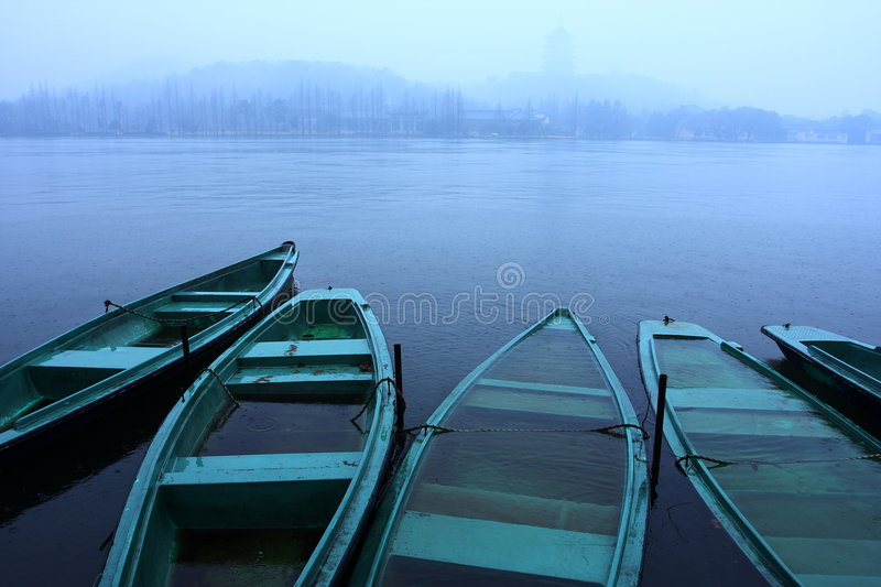 Download Boats in the lake raining stock image. Image of west, hangzhou - 7587113