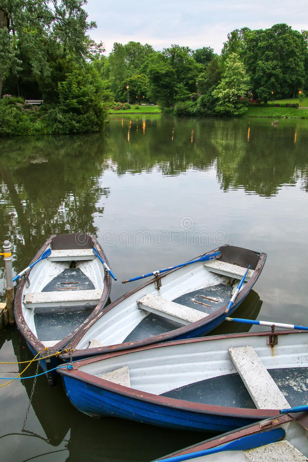Boats by the lake shore in Kurpark, Wiesbaden, Hesse, Germany royalty free stock image
