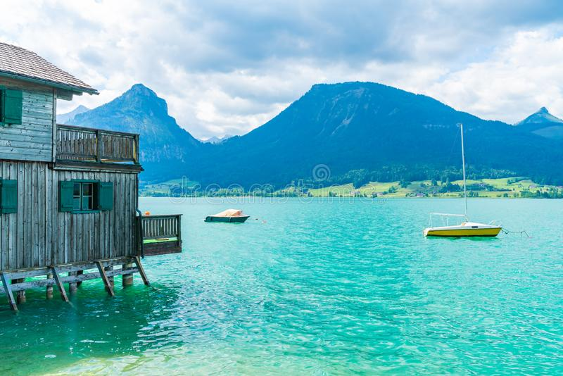 Boats on Lake Wolfgangsee, Austria. Small boats on Lake Wolfgangsee in the Salzkammergut resort region, Austria stock photography