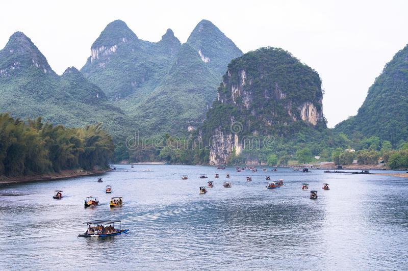 Boats Li-River China. Boats and rafts on the Li-River near Yangshuo stock photo