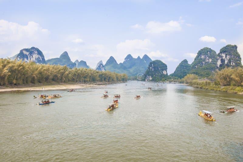 Li River China. Boats and rafts on the Li-River near Yangshuo in China stock photo