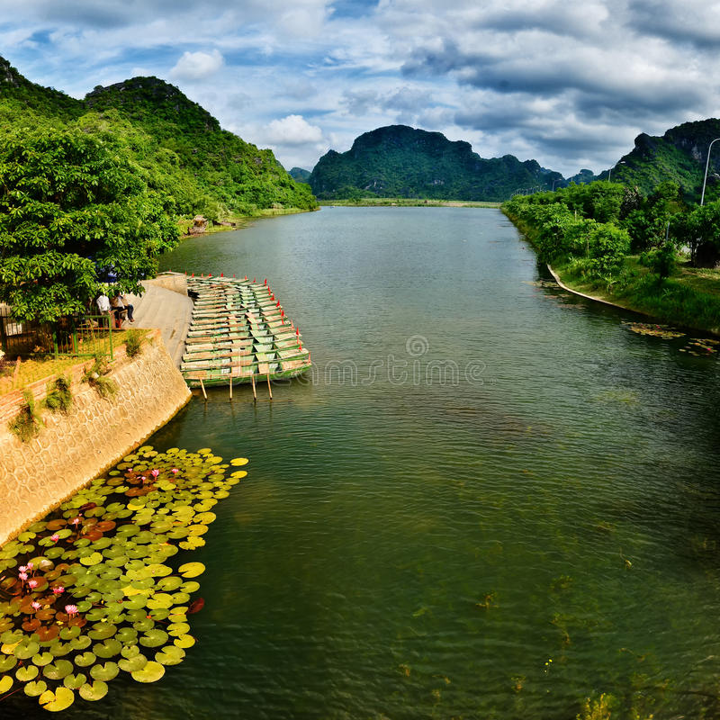 Boats line up at the Trang An wharf. Trang An Landscape Complex is located in Ninh Binh City, about 90km to the southeast of Ha Noi stock photography