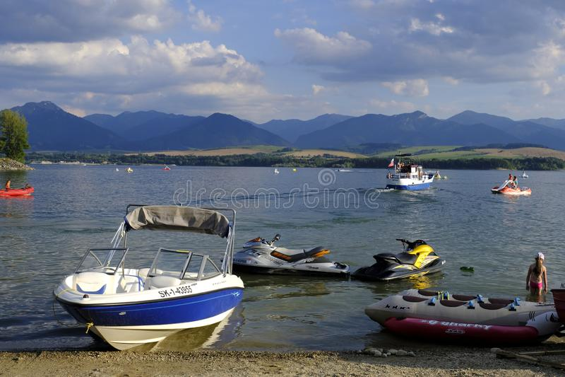 Boats on Liptovska Mara Lake, Slovakia landscape, High Tatra Mountains royalty free stock photo