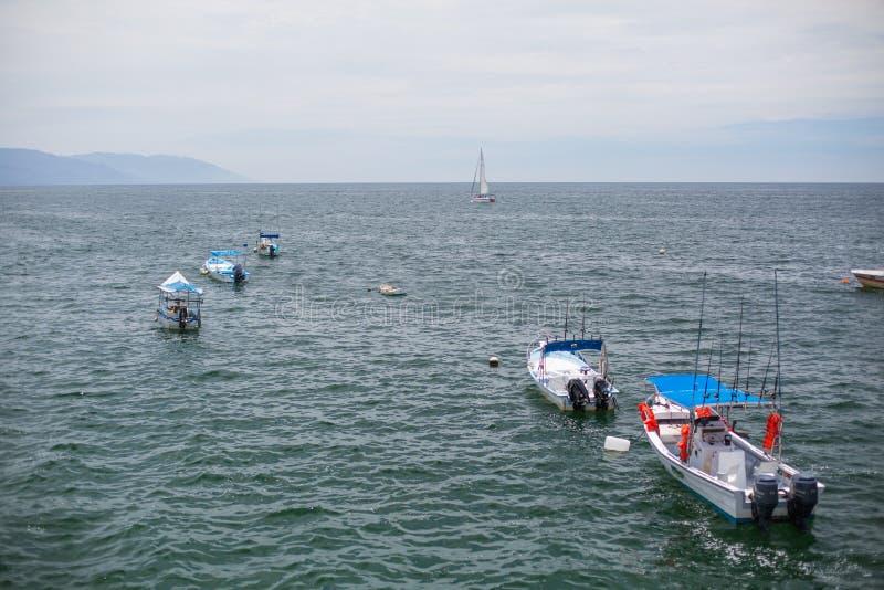 Boats at Los Muertos Beach. Boats waiting at Los Muertos Pier and Beach, Puerto Vallarta, Jalisco, Mexico stock image
