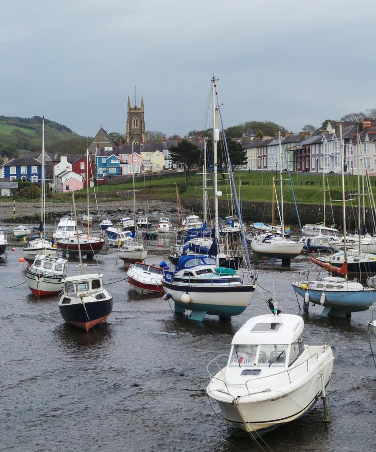 Boats at Low tide. Aberaeron, United Kingdom - May 29 2013: Boats resting on the beach at low tide stock photography
