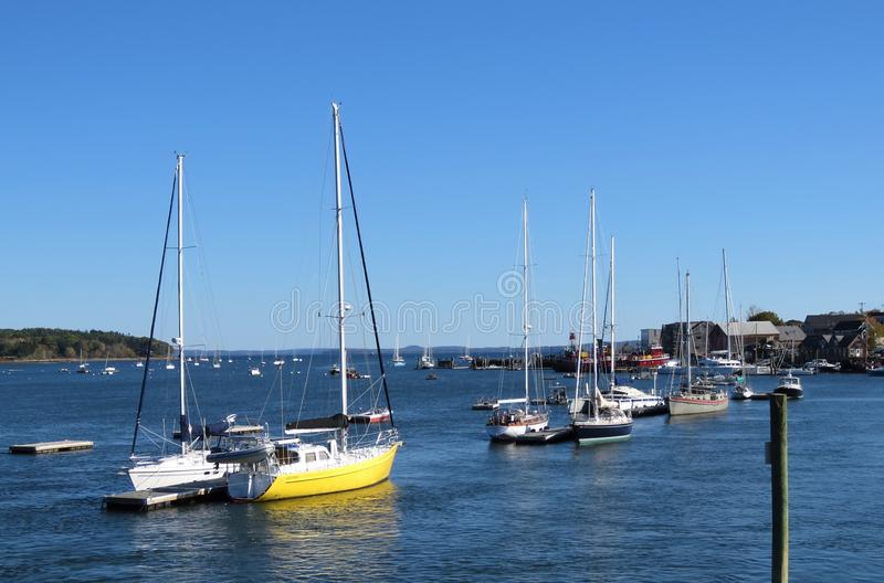 Boats in Maine harbor stock images