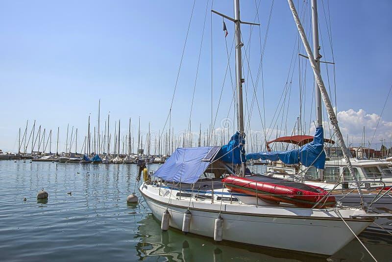 Boats in marina in Geneva lake bay harbor in Lausanne, Switzerland royalty free stock image
