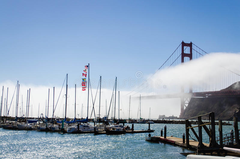 Boats at the marina beside the Golden Gate Bridge stock images